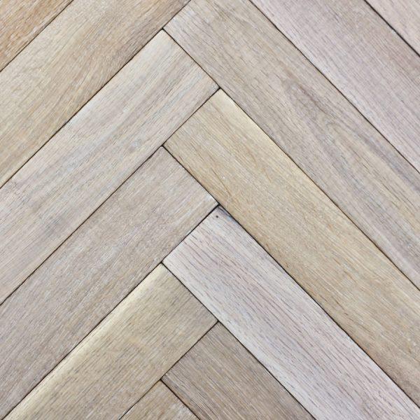 Larvik Aged Natural White Herringbone Flooring