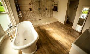 Bathroom Hard Wood Flooring with Tiled Shower Area