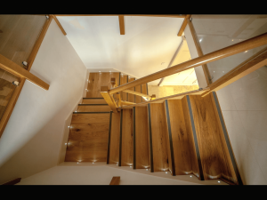 Wooden Stairs with lights and grey step edging