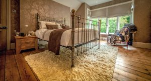 Beautiful bedroom with wooden flooring and a vintage feel