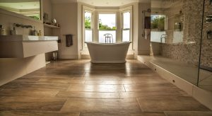 Wooden Floor bathroom with floating sink and tiled shower area