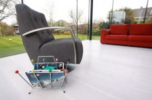 Hard Wood Flooring, Single Brown Swivel Arm Chair and Red Sofa