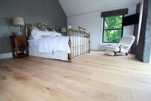 Wooden flooring in open bedroom