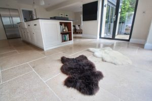 Tiled Kitchen Flooring with fluffy rugs