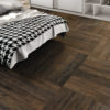 Schervage Dark Oak Wood Effect Bedroom Floor Tile with houndstooth blanket