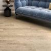 Schervage Medium Brown Oak Wood Tile and modern blue sofa