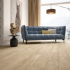 Schervage Mid Brown Wood Effect Living Room Floor tile with contemporary blue sofa